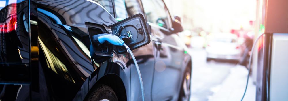 ev electric car at charging station